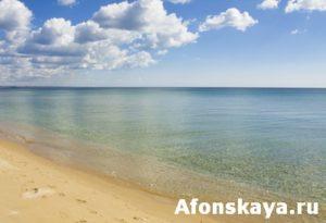 Sea, sandy beach and clouds