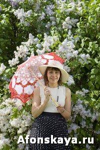Lady with parasol near lilac