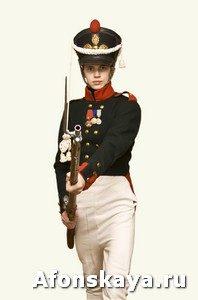 Boy in uniform of soldier in XIX century