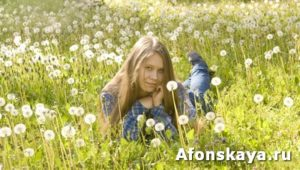 Girl with white dandelions