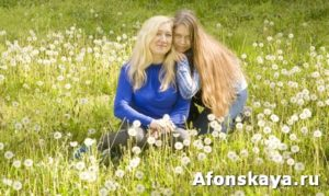 Mother and daughter with white dandelions