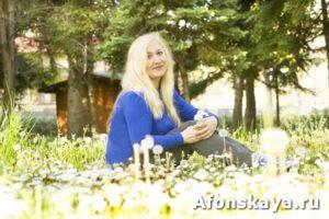 Blond European woman on meadow