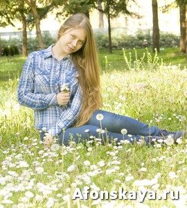 Girl on meadow with flowers