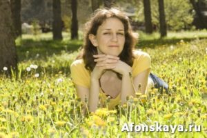 Young woman with yellow dandelions