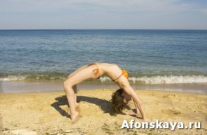 Woman making fitness on beach