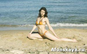 Woman doing fitness on beach