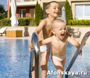 Little boys near swimming pool
